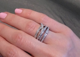 a promise ring on a woman's hand
