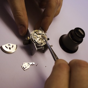 a watch being repaired