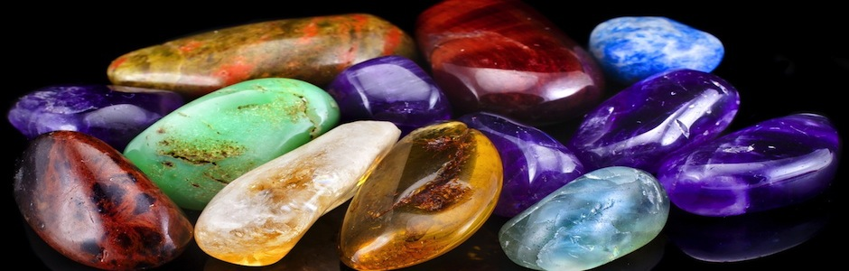 Group of natural colorful raw gemstones on black  background